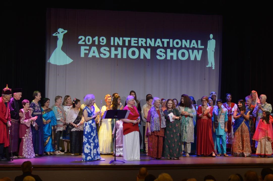 Residents and employees are on stage during the International Fashion Show during the Ashby Ponds Diversity Week.