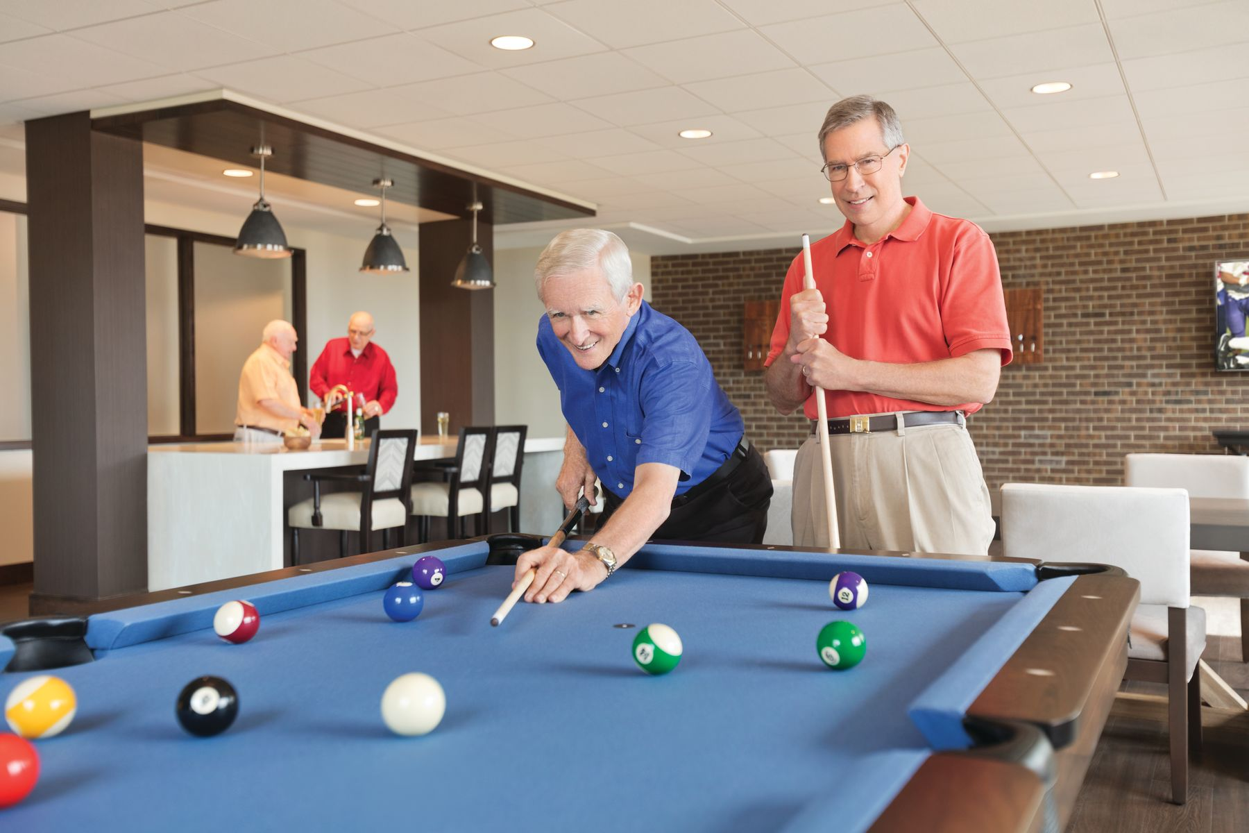 Residents shoot a game of pool in one of the club rooms at Ashby Ponds.
