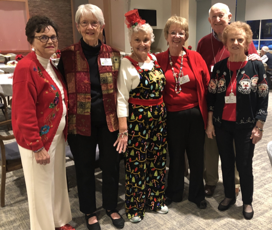 Residents of Ashby Ponds are photographed in Farmwell Hall ahead of their holiday party on December 12.