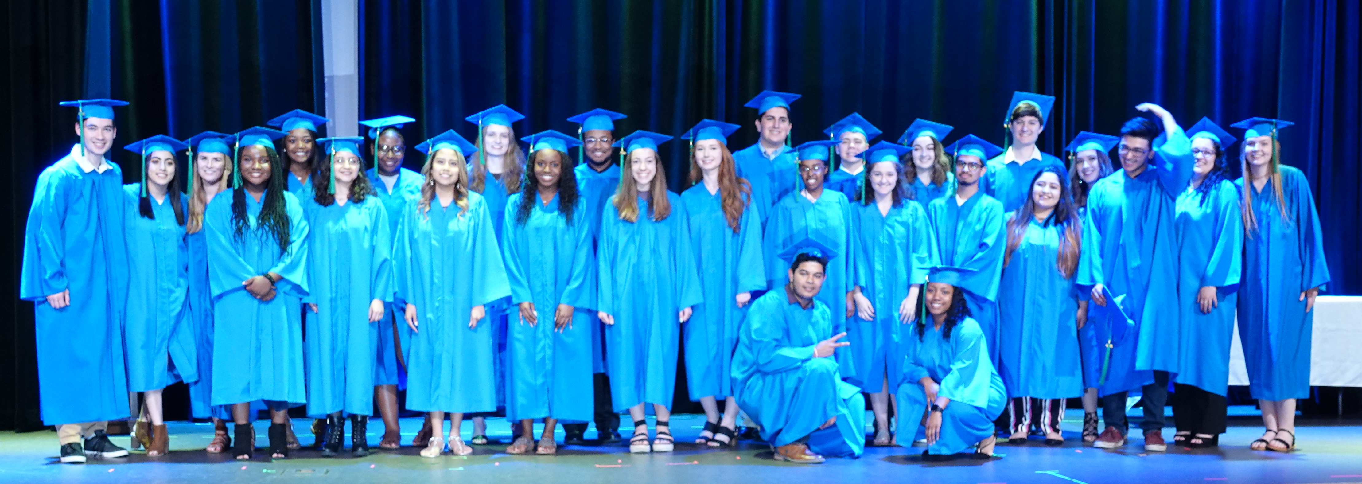 The 27-member Student Scholars Class of 2019 stand together on stage at Ashby Ponds following the community's scholarship awards ceremony on May 20.