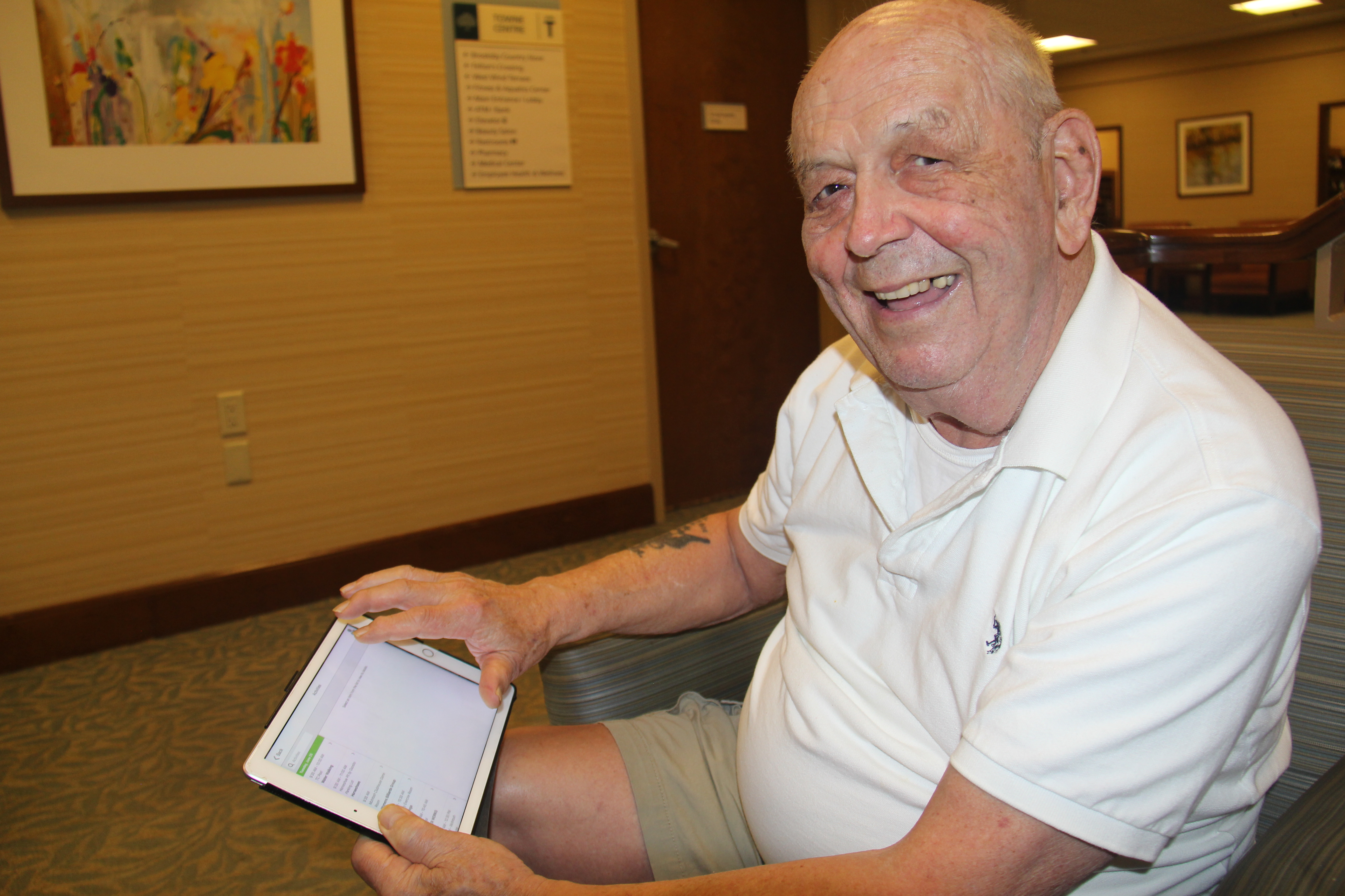Photo caption: Larry Denis uses a variety of web-based solutions to support his active lifestyle at Brooksby Village, including the MyErickson app, a tool that provides immediate access to the programs and services offered at the Peabody community.