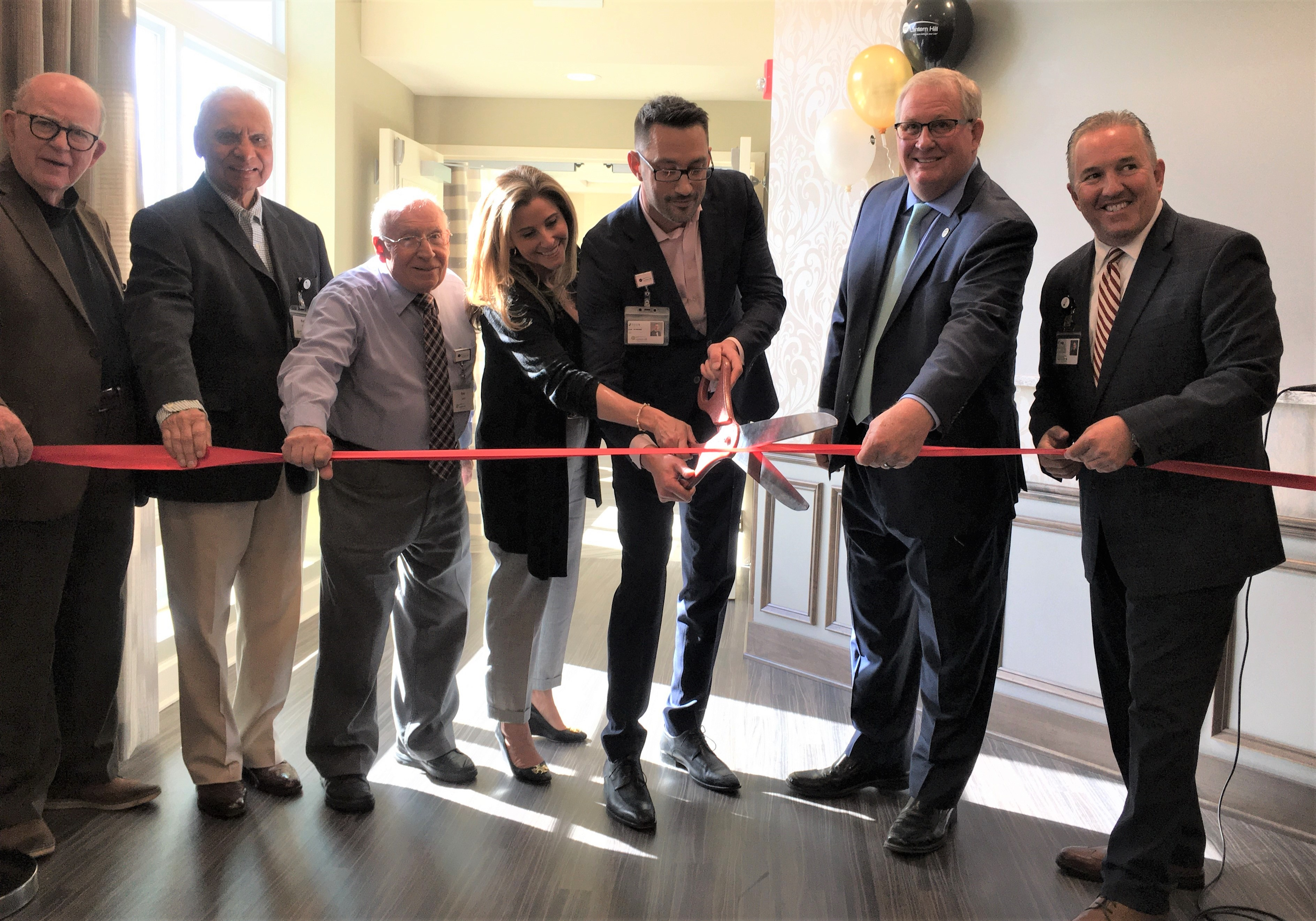 Lantern Hill staff and residents cut ribbon at Bistro 1720 opening