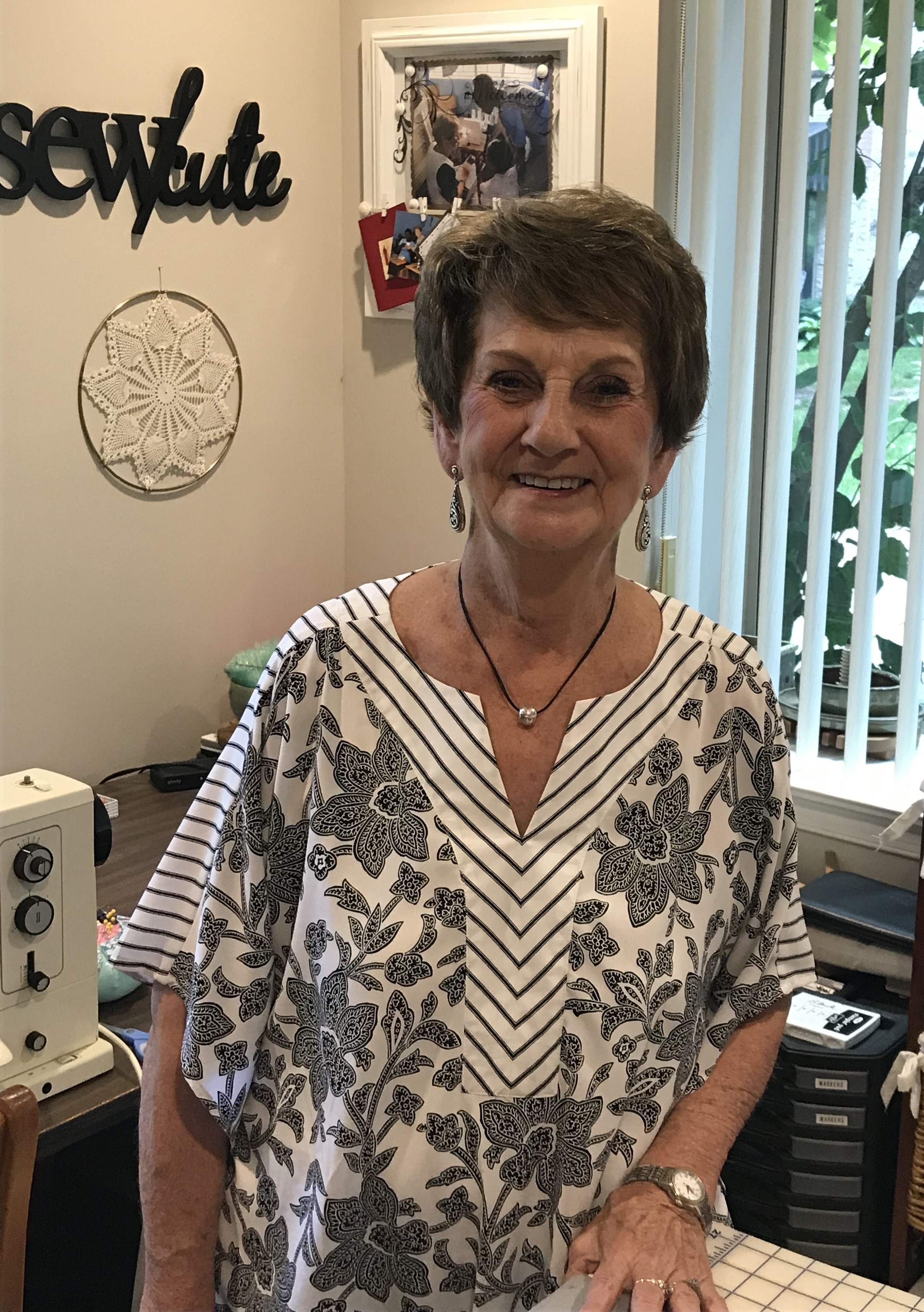 Martie Noel, a resident of Oak Crest, is photographed in the sewing room of her apartment home.