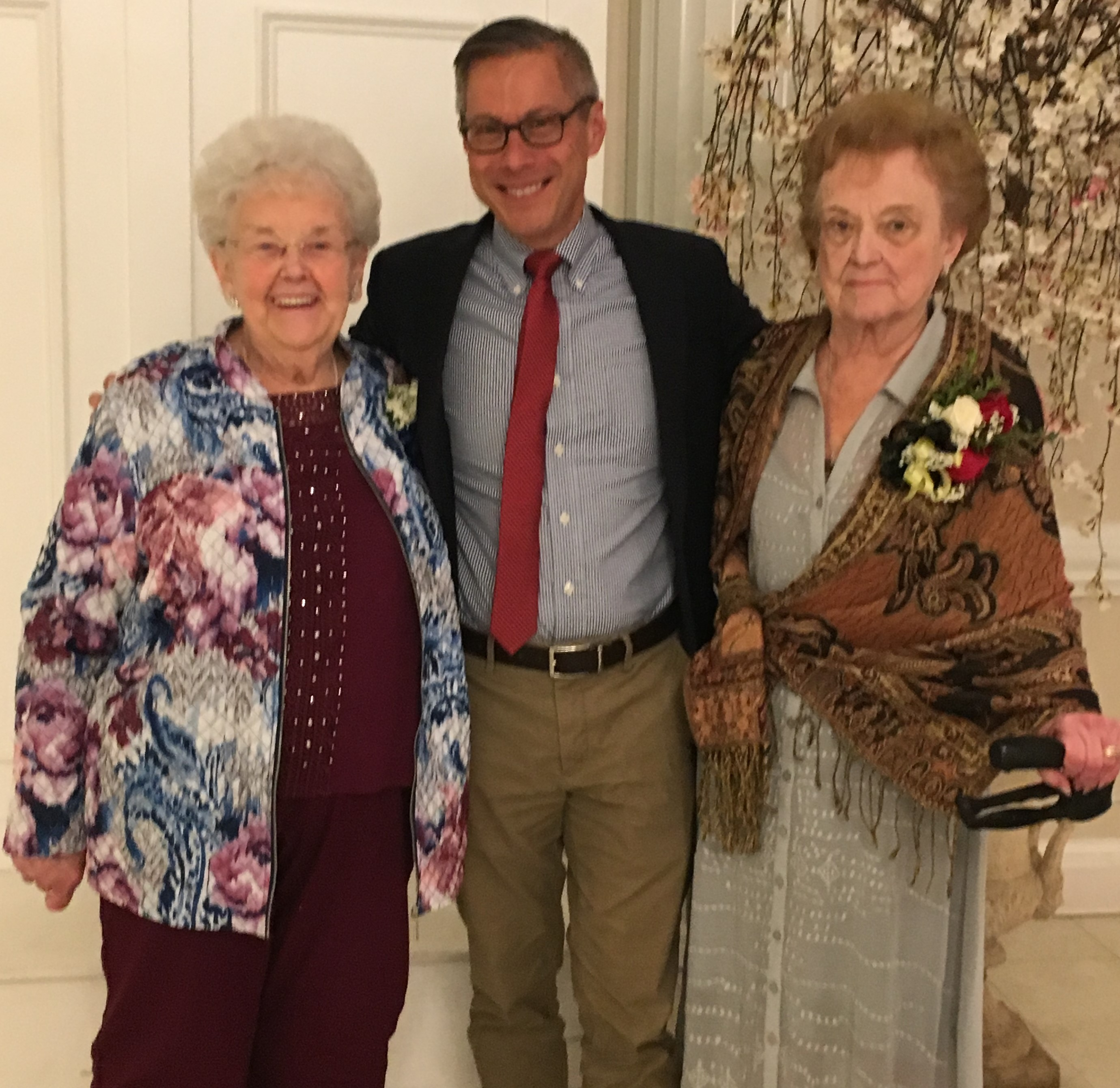 Darlene Koch (L) and Sally Bowerman (R), residents of Oak Crest, were inducted into the Maryland Senior Citizens Hall of Fame for their volunteer service. They are joined by Bill Tian, Associate Executive Director of Oak Crest.