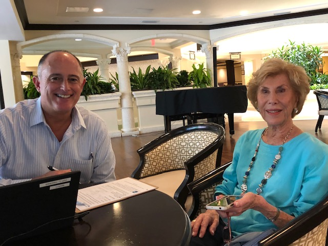 Marty Bores, Manager of Resident Services, and Devonshire Community Member Lois Edelstein using the MyErickson app.