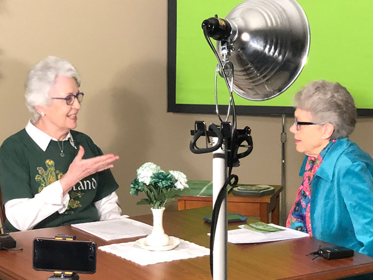 Resident Cathleen Turick (left) shares information about her Irish roots with Karen Cox, host of 1851 Studio Chats, Tallgrass Creek's new talk show. Cathleen was a guest earlier this year on the monthly show which focuses on residents' unique experiences