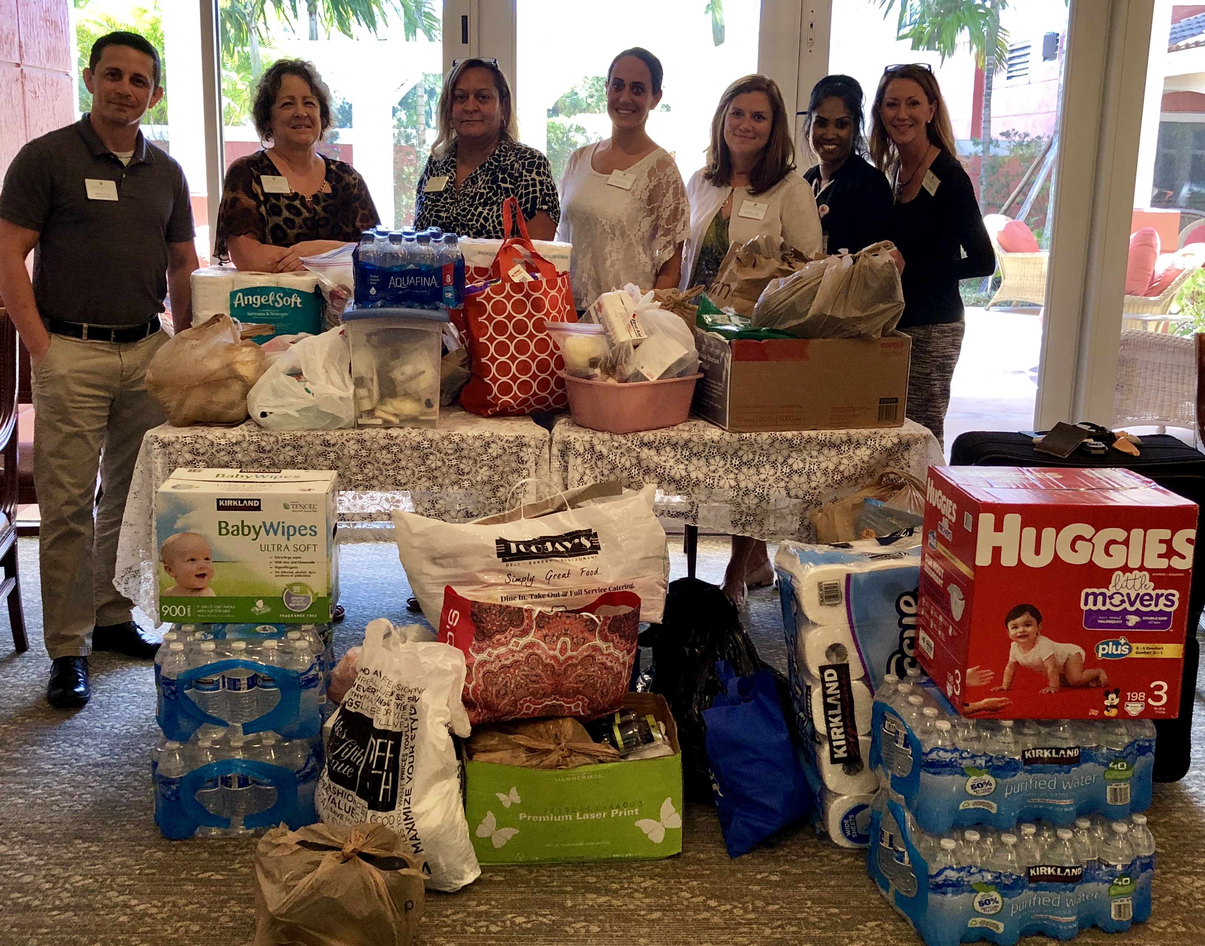 Photo:  Devonshire at PGA National and Chatsworth employees with some of the items they have collected for the Bahamas.